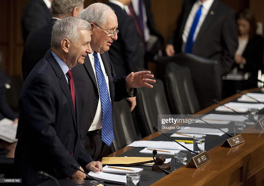 Sen. Jack Reed, D-RI., and Chairman Carl Levin, D-MI., look over the large number of witnesses standing before them at the Armed Services Committee hearing on pending legislation regarding sexual assaults in the military in the Senate Hart Office Building on June 4, 2013.