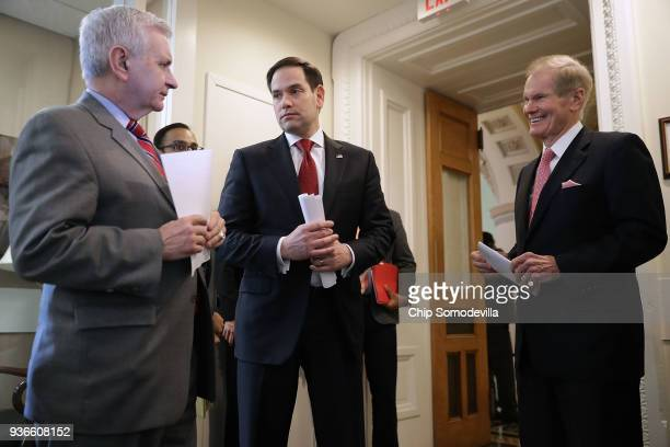 Sen Jack Reed Sen Marco Rubio and Sen Bill Nelson talk about their bipartisan legislation to create red flag gun laws before a news conference at the...