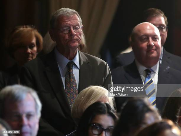 Sen James Inhofe listens to Acting EPA Administrator Andrew Wheeler speak to employees at the Environmental Protection Agency headquarters on July 11...