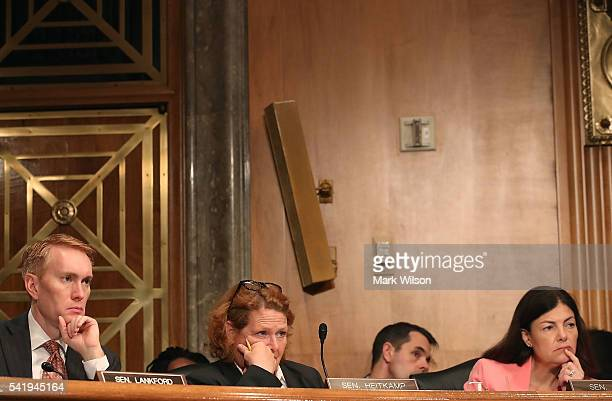 Sen James Langford Sen Heidi Heitkamp and Sen Kelly Ayotte listen to testimony during a Senate Homeland Security and Governmental Affairs Committee...