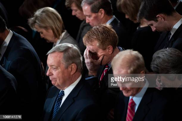 Sen James Lankford bows his head in prayer during a ceremony for former US President George HW Bush at the US Capitol Rotunda on December 03 2018 in...