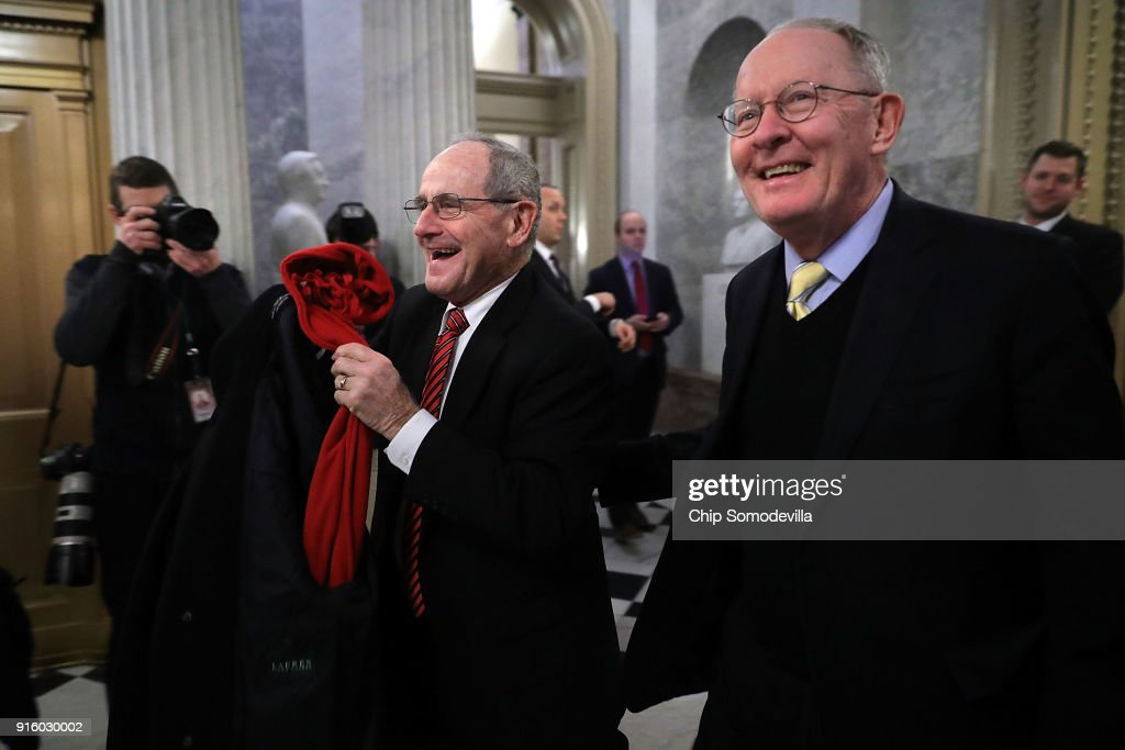 Sen. James Risch (R-ID) (L) and Sen. Lamar Alexander (R-TN) leave the U.S. Capitol following early morning votes February 9, 2018 in Washington, DC. Despite an attempt by Sen. Rand Paul (R-KY) to slow down the process, the Senate passed bipartisan legislation to continue to fund the government and lift strict budget caps. With the government officially in a shut down, the legislation now goes to the House of Representatives.