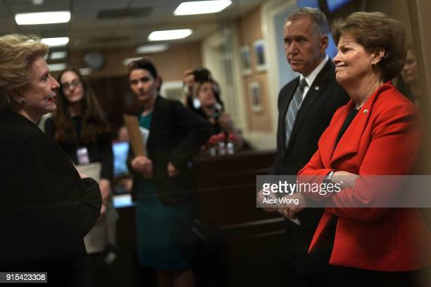 S Sen Jeanne Shaheen and Sen Thom Tillis listen to Sen Debbie Stabenow prior to a news conference at the Capitol February 7 2018 in Washington DC Sen...