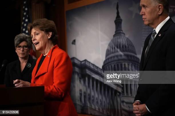 S Sen Jeanne Shaheen speaks as Sen Joni Ernst and Sen Thom Tillis listen during a news conference at the Capitol February 7 2018 in Washington DC Sen...