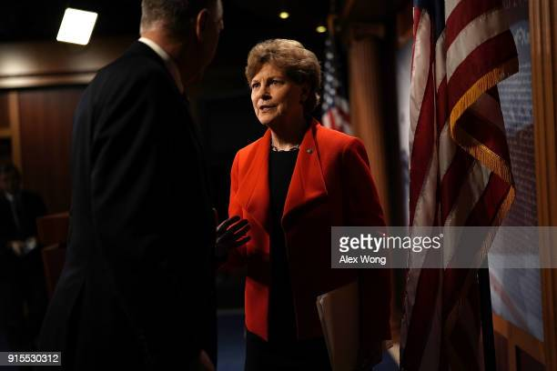 S Sen Jeanne Shaheen talks to Sen Thom Tillis after a news conference at the Capitol February 7 2018 in Washington DC Sen Shaheen and Sen Joni Ernst...