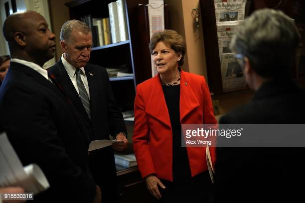 S Sen Jeanne Shaheen talks to Sen Thom Tillis and Sen Tim Scott prior to a news conference at the Capitol February 7 2018 in Washington DC Sen...