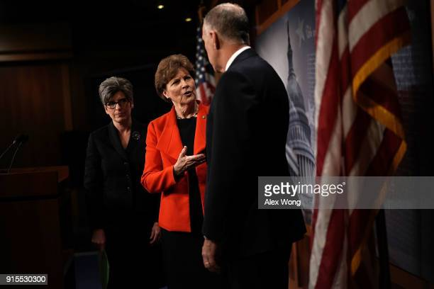 S Sen Jeanne Shaheen talks to Sen Thom Tillis as Sen Joni Ernst looks on after a news conference at the Capitol February 7 2018 in Washington DC Sen...