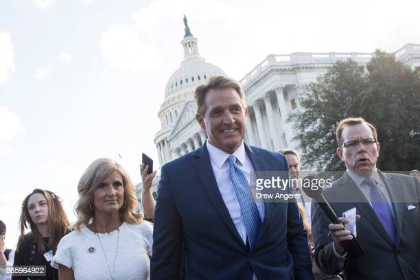 Sen Jeff Flake and his wife Cheryl Flake leave the US Capitol as they are trailed by reporters October 24 2017 in Washington DC Flake announced that...