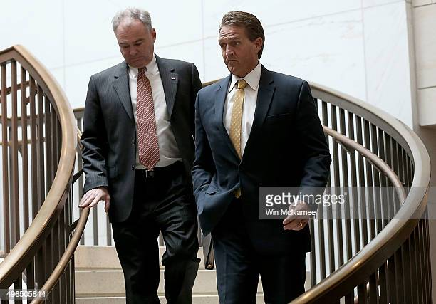 Sen Jeff Flake and Sen Tim Kaine walk to a closed briefing given by Brett McGurk deputy special presidential envoy for theÊGlobal CoalitionÊto...