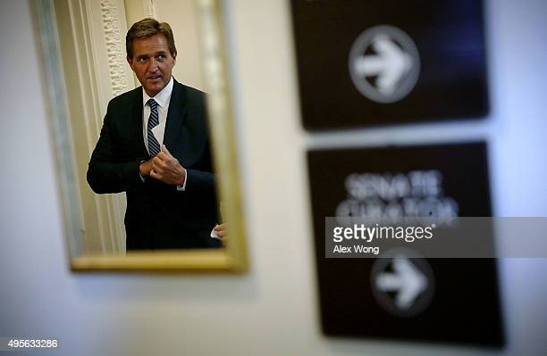 S Sen Jeff Flake arrives at a news conference November 4 2015 on Capitol Hill in Washington DC The senator held the news conference to release and...