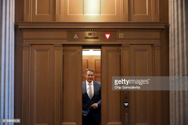 Sen Jeff Flake boards an elevator in the US Captiol following a Republican caucus luncheon February 8 2018 in Washington DC Senate Majority Leader...