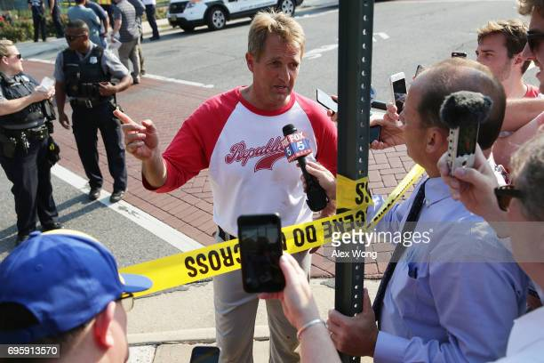 S Sen Jeff Flake briefs members of the media near Eugene Simpson Stadium Park where a shooting took place on June 14 2017 in Alexandria Virginia US...