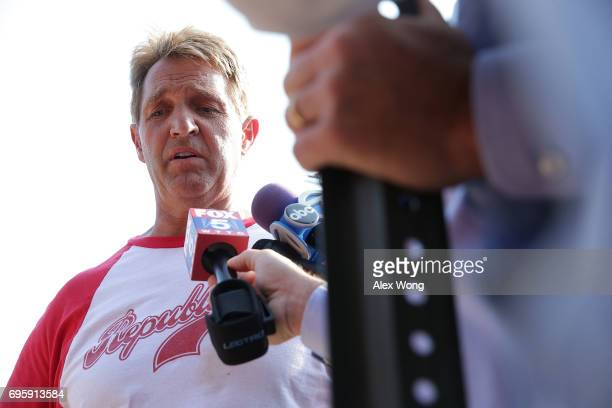 S Sen Jeff Flake briefs members of the media near Eugene Simpson Stadium Park where a shooting took place on June 14 2017 in Alexandria Virginia US...