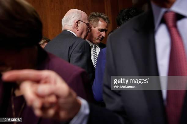Sen Jeff Flake confers with Democratic senator Sen Patrick Leahy while leaving a Senate Judiciary Committee meeting in the Dirksen Senate Office...