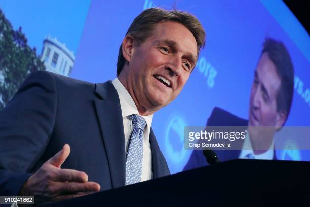 Sen Jeff Flake delivers remarks during the US Conference of Mayors 86th annual Winter Meeting at the Capitol Hilton January 25 2018 in Washington DC...