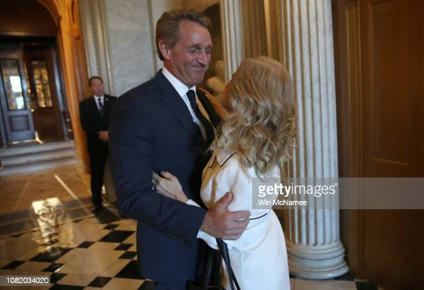Sen Jeff Flake hugs his wife Cheryl after delivering his farewell speech on the floor of the US Senate December 13 2018 in Washington DC During his...