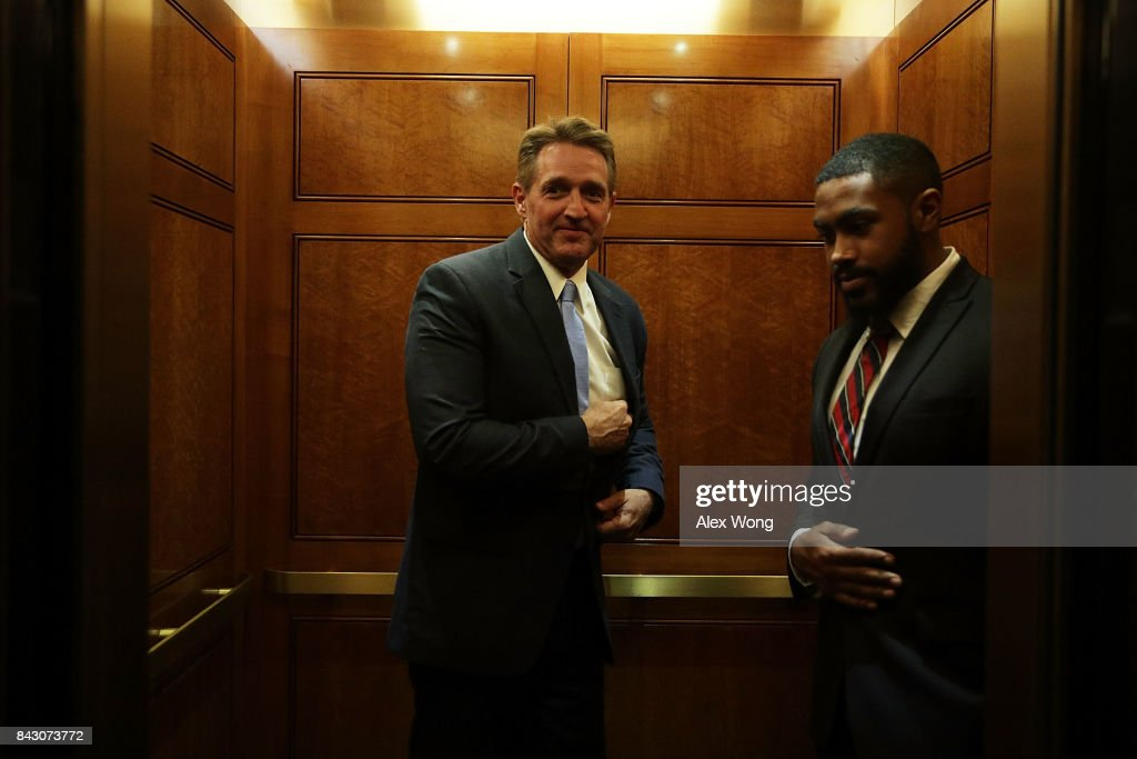 U.S. Sen. Jeff Flake (R-AZ) (L) leaves after a vote at the Capitol September 5, 2017 in Washington, DC. Congress is back from summer recess with a heavy legislative agenda in front of them.