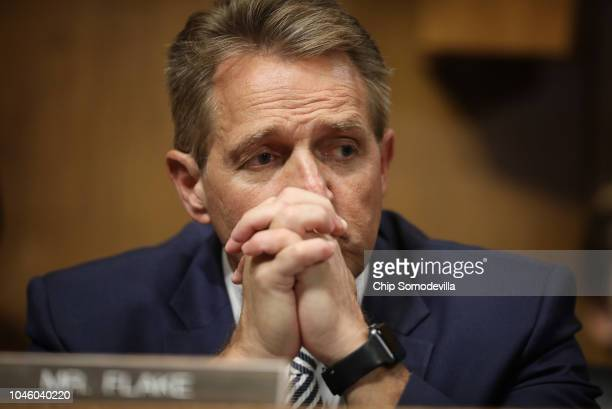 Sen Jeff Flake listens to Democratic senators speak during a Senate Judiciary Committee meeting on September 28 2018 in Washington DC The committee...