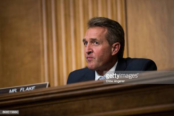 Sen Jeff Flake looks on during a Senate Foreign Relations Committee hearing concerning the authorizations for use of military force October 30 2017...