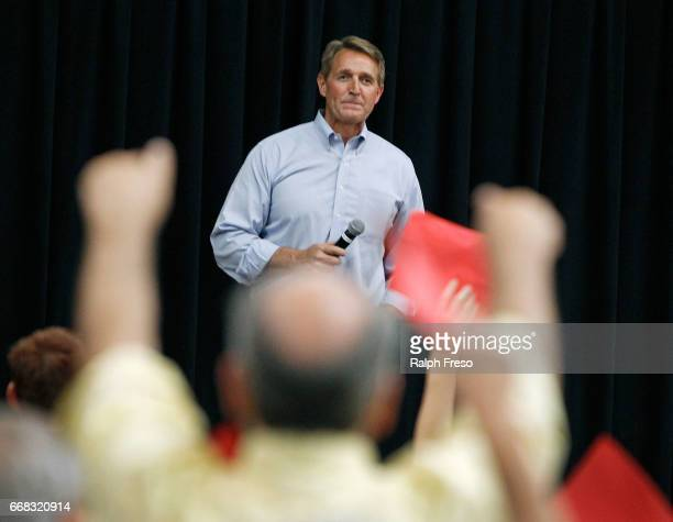 S Sen Jeff Flake looks out over a crowd of angry constituents at a town hall event at the Mesa Convention Center on April 13 2017 in Mesa Arizona It...