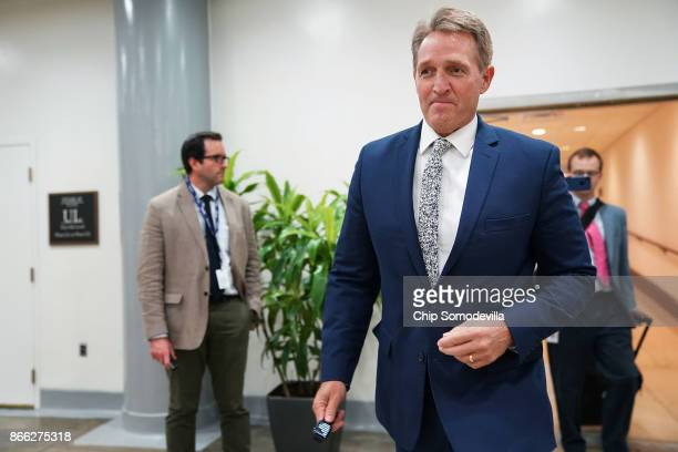 Sen Jeff Flake moves through the US Capitol basement October 25 2017 in Washington DC Flake announced that he will not be seeking reelection and he...