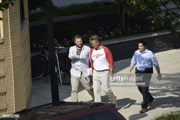 Sen Jeff Flake of Arizona walks near the crime scene of an early morning shooting in Alexandria Virginia June 14 2017 At least five people people...