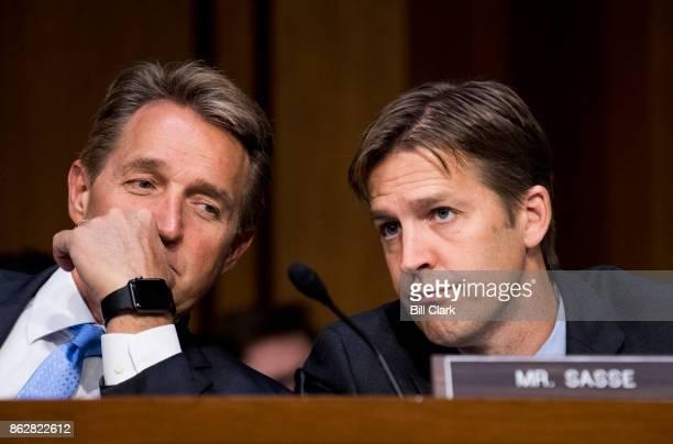 Sen Jeff Flake RAriz and Sen Ben Sasse RNeb talk as Attorney General Jeff Sessions testifies during the Senate Judiciary Committee hearing on Full...