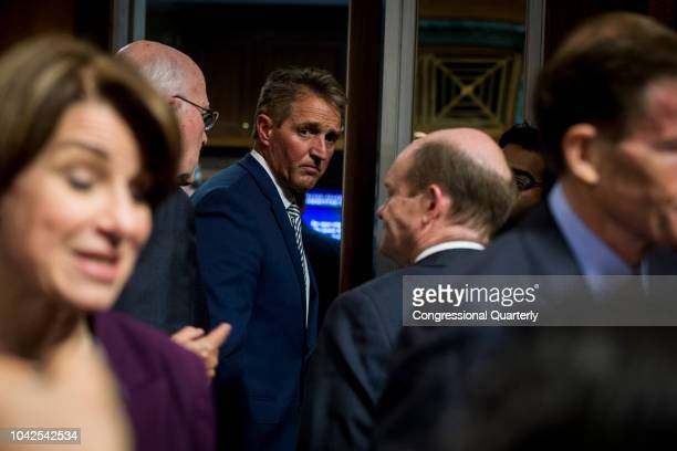 Sen Jeff Flake RAriz exits the Senate Judiciary Committee meeting about the Supreme Court nominee Brett Kavanaugh Friday Sept 28 2018