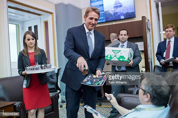 Sen. Jeff Flake, R-Ariz., hands out treats and his annual report outlining government waste to reporters in the Capitol's Senate press gallery, May...