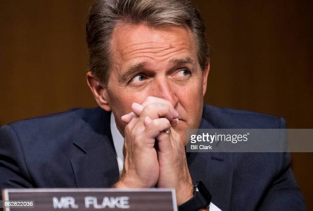 Sen Jeff Flake RAriz listens as Attorney General Jeff Sessions testifies during the Senate Judiciary Committee hearing on Full committee hearing on...