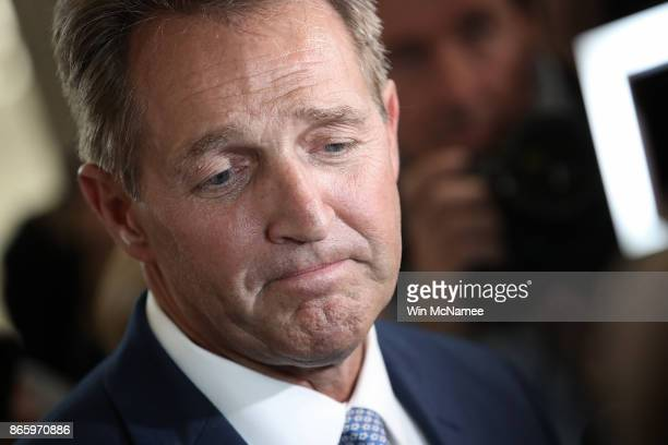 Sen Jeff Flake speaks to reporters after announcing he will not seek reelection October 24 2017 in Washington DC Flake announced that he will leave...