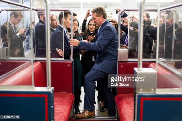 Sen Jeff Flake speaks to reporters following a vote on Capitol Hill on January 11 2018 in Washington DC The house voted to reauthorize the Foreign...