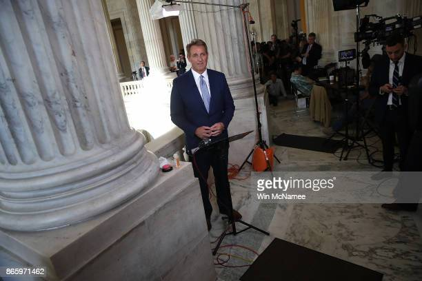 Sen Jeff Flake speaks to reporters on Capitol Hill after announcing he will not seek reelection October 24 2017 in Washington DC Flake announced that...