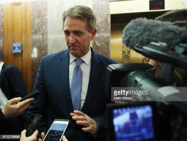 Sen Jeff Flake speaks to the media about immigration after attending a bipartisan meeting in Sen Susan Collins office on Capitol Hill January 25 2018...