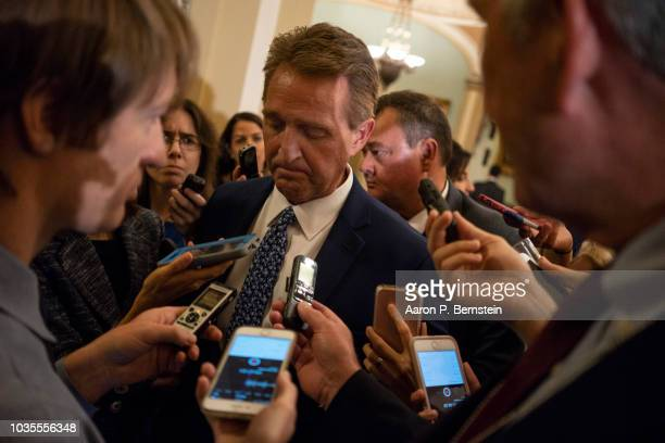 Sen Jeff Flake speaks with reporters ahead of the weekly policy luncheons on Capitol Hill September 18 2018 in Washington DC Senate Majority Leader...