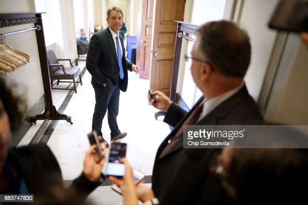 Sen Jeff Flake talks with reporters in between votes at the US Capitol December 1 2017 in Washington DC Senate Republicans said they have the votes...