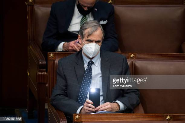Sen. Jeff Merkley, D-Ore., attends the joint session of Congress to certify the Electoral College votes of 2020 presidential election in the House...
