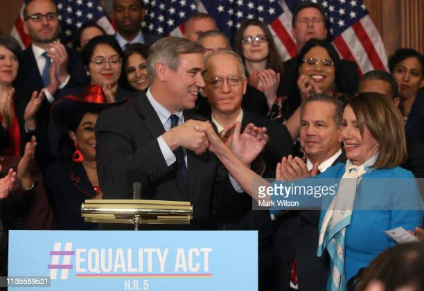 Sen Jeff Merkley introduces House Speaker Nancy Pelosi during a news conference where House and Senate Democrats introduced the Equality Act of 2019...