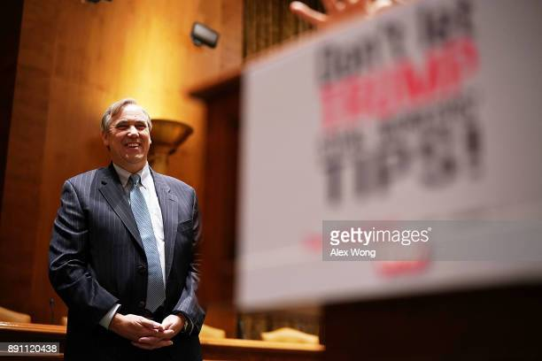 S Sen Jeff Merkley listens during a news briefing December 12 2017 on Capitol Hill in Washington DC Sen Merkley spoke on the Labor Department's...