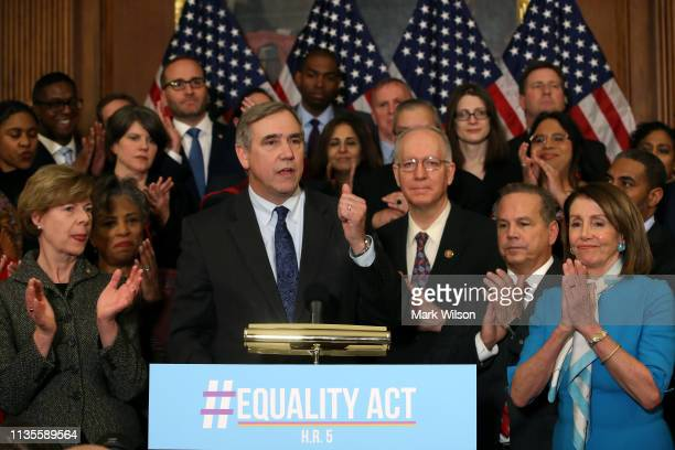 Sen Jeff Merkley speaks alongside House Speaker Nancy Pelosi during a news conference where House and Senate Democrats introduced the Equality Act of...