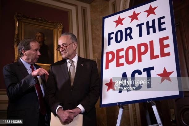 Sen. Jeff Merkley speaks with Senate Minority Leader Chuck Schumer during a press conference to unveil the For The People Act at the U.S. Capitol,...