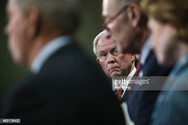 S Sen Jeff Sessions listens during a news conference on currency and trade February 10 2015 on Capitol Hill in Washington DC A group of bipartisan...