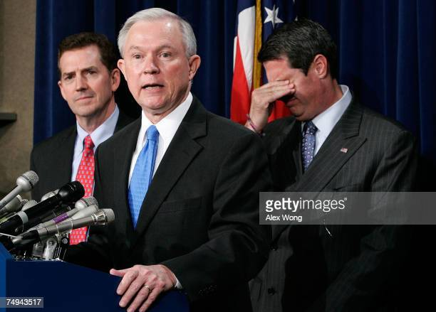 S Sen Jeff Sessions speaks as Sen Jim DeMint and Sen David Vitter listen during a news conference after a cloture vote on an immigration reform bill...