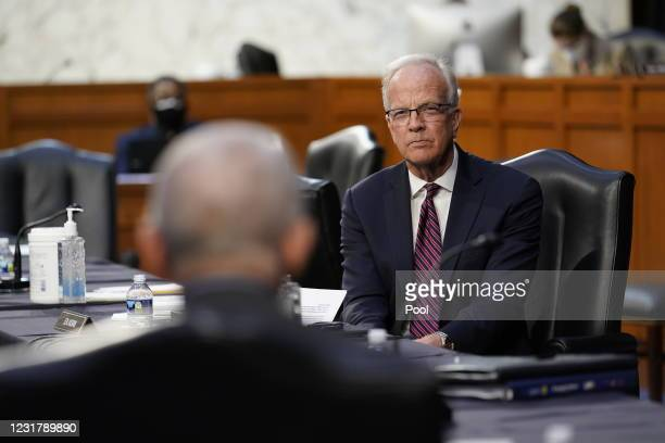 Sen. Jerry Moran listens as Dr. Anthony Fauci, director of the National Institute of Allergy and Infectious Diseases, speaks during a Senate Health,...