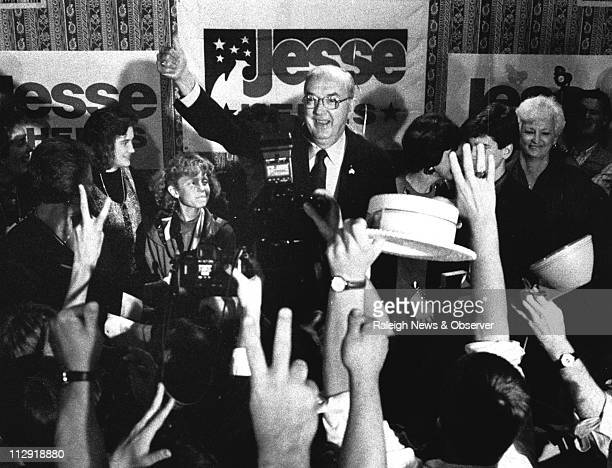 Sen Jesse Helms gives the thumbs up to his supporters at the Brownstone Hotel during his victory speech Tuesday Nov 6 1990