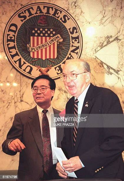 Sen Jesse Helms RNC Chairman of the Senate Foreign Realtions Committee stands with Harry Wu before his testimony 04 May on Capitol Hill about China's...