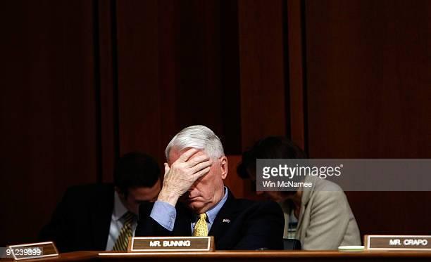 Sen Jim Bunning rubs his eyes during the full Senate Finance Committee markup of 'The America's Health Future Act' September 29 2009 in Washington DC...