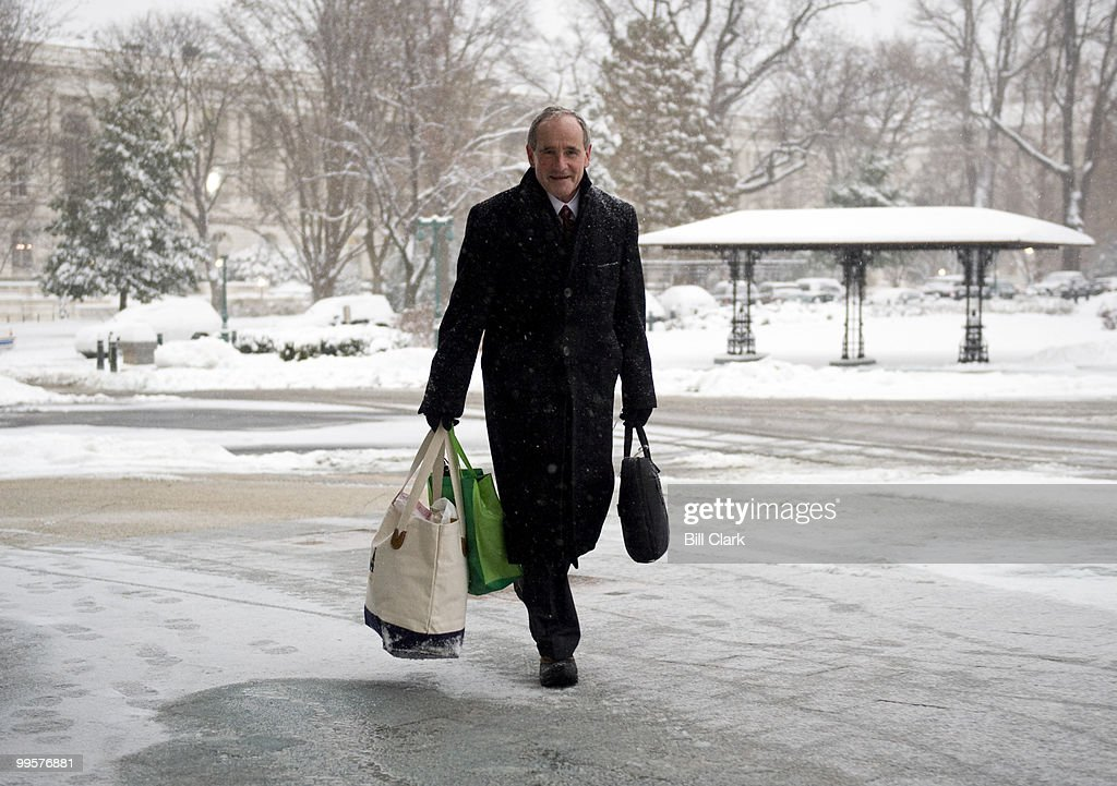 Sen. Jim Risch, R-Idaho, arrives at the Capitol during a snow storm to vote on the defense bill on Saturday morning, Dec. 19, 2009.