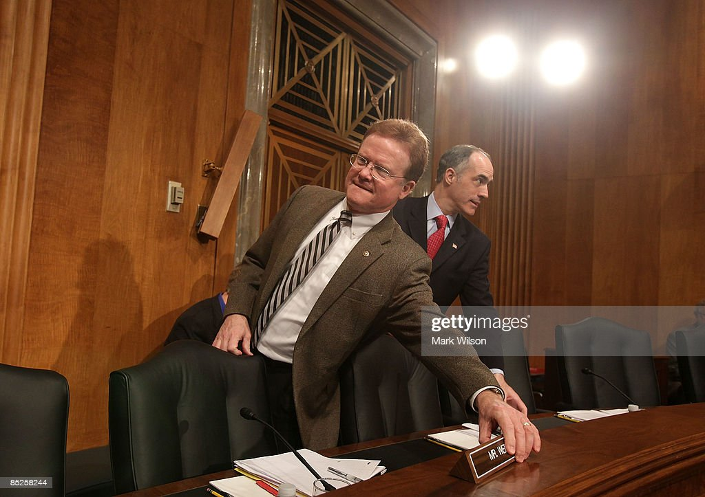 Sen. Jim Webb (D-VA) (L) puts down his name plaque after arriving for a Senate Foreign Relations Committee hearing on Capitol Hill on March 5, 2009 in Washington, DC. The SFRC committee, chaired by Sen. John Kerry (D-MA), is hearing testimony on the United States' strategy in dealing with Iran and reports on their nuclear program.