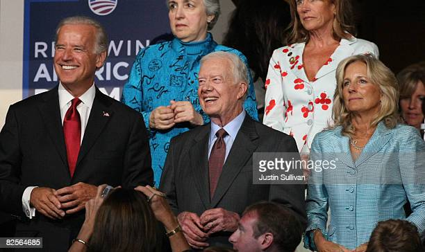 US Sen Joe Biden former president Jimmy Carter and Jill Biden watch the proceedings on day two of the Democratic National Convention at the Pepsi...